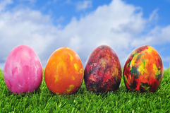 Easter eggs. Some easter eggs of different colors on the grass Royalty Free Stock Images
