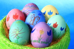 Easter eggs. Colorfully painted Easter eggs before blue background Royalty Free Stock Photos