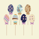 Easter Eggs. A stylized set of Easter eggs, with a variety of designs: stars, rabbits, circles, the Turkish cucumber, roses, stripes. Eggs on a stick with a pink Royalty Free Stock Image