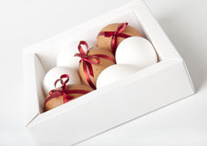 Easter eggs. In a white box on a white background Stock Image