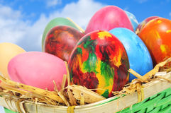 Easter eggs. Some easter eggs of different colors in a basket Stock Photo