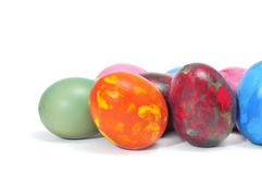 Easter eggs. Some easter eggs of different colors on a white background Stock Photos