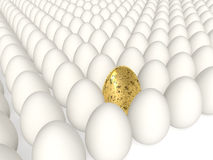 Easter eggs. Rows of white eggs and one golden in the plane Royalty Free Stock Photos