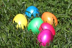Easter eggs. Some colorful easter eggs lying the the grass stock images