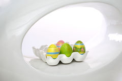 Easter eggs. Multicolored easter eggs on the green backgrown and rabbit Stock Images