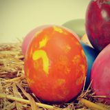 Easter eggs. Some easter eggs of different colors on a nest, with a retro effect Stock Image