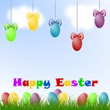 Easter eggs. Colorized Easter eggs on the grass and air Royalty Free Stock Photos