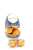 Easter Eggs. Mini Golden Chocolate Eggs Inside a Decorated Egg Ornament Royalty Free Stock Photo