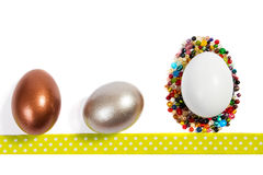 Easter eggs. White, copper and silver easter eggs and pearls isolated on white background Stock Photos