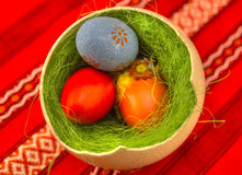 Easter eggs. Colored Easter eggs in one big ostrich egg with grass Stock Image