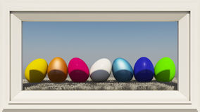 Easter eggs. Colorful eggs on hay framed photo frame Stock Photography