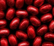 Easter eggs. Bright red foil wrapped easter eggs stock photos