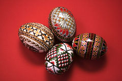 Easter eggs. Four easter eggs isolated on red Royalty Free Stock Photos
