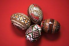 Easter eggs. Four easter eggs isolated on red Stock Illustration
