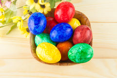 Easter eggs. Colorful Easter eggs in wooden dish Stock Images