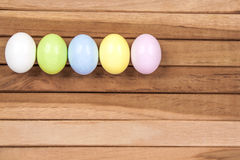Easter Eggs. Five colored easter eggs on a wooden background Royalty Free Stock Image
