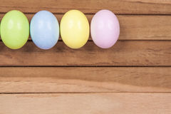 Easter Eggs. Five colored easter eggs on a wooden background Royalty Free Stock Photos