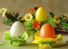 Easter Eggs. Easter plastic eggs, table decoration with felt, spring flowers at background stock photography