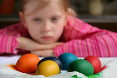 Easter eggs. Little girl waiting while eggs are drying Stock Photo