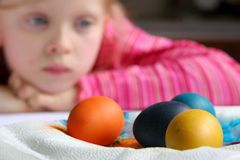 Easter eggs. Little girl waiting while easter eggs are drying Stock Photos