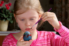 Easter eggs. Little girl painting easter eggs Stock Image