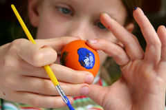 Easter eggs. Young girl painting easter eggs Royalty Free Stock Photo