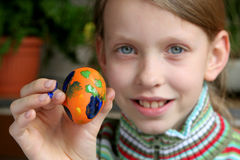 Easter eggs. Young girl showing easter egg Stock Images