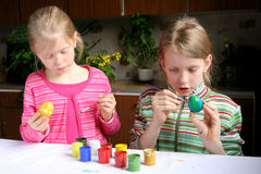 Easter eggs. Two girls painting easter eggs Stock Image