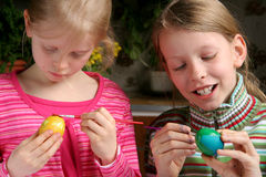 Easter eggs. Two girls painting easter eggs Stock Photo