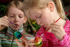 Easter eggs. Two girls painting easter eggs Royalty Free Stock Photos