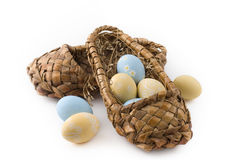Easter eggs. In bast shoes on white background Stock Images