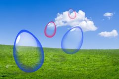 Easter Eggs. Easter glass eggs in a green meadow against a blue sky Royalty Free Stock Photography