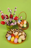 Easter eggs. Plate with Easter eggs and cake royalty free stock photography