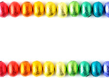 Easter-eggs. Wrapped easter-eggs in rainbow colors on white Stock Photo