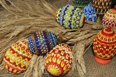 Easter eggs. From beads and dry ear Stock Photos