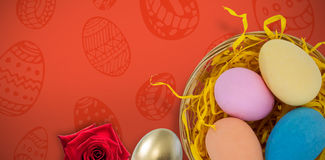 Easter eggs against red background Stock Photo