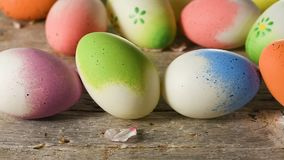 Easter eggs and almond blossom panning, on old wooden floor stock footage