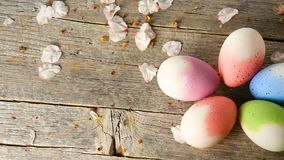 Easter eggs and almond blossom panning, on old wooden floor stock video
