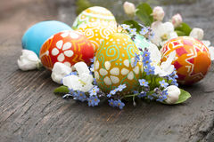 Easter Eggs And Spring Flowers Stock Images