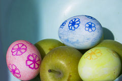 Easter eggs and apples Stock Images