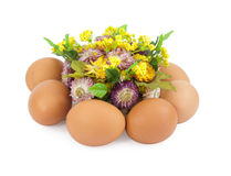 Easter eggs around flowers Royalty Free Stock Photo