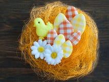 Easter eggs in an artificial nest Stock Photos
