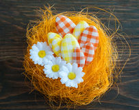 Easter eggs in an artificial nest Stock Photo