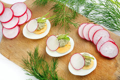 Easter eggs with avocado paste and radish Stock Photo