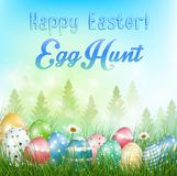 Easter eggs Background with field of trees and colored eggs in the grass Stock Photos