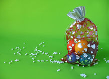 Easter eggs in bag with hearts and scattered beads Royalty Free Stock Images