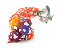 Easter eggs in bag with hearts on white Stock Images