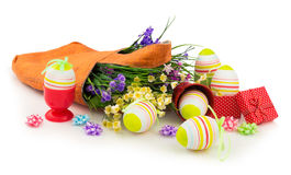 Easter eggs and bag with spring flowers Stock Photography