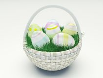 Easter eggs in a basket. Easter eggs in a basket on a white background Stock Photo