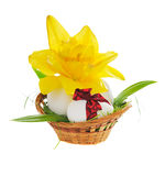 Easter eggs in basket. With yellow lily  isolated  on white background Royalty Free Stock Photo